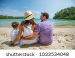 family on vacation at the... | Shutterstock . vector #1033534048
