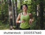 girl running in park in the... | Shutterstock . vector #1033537660
