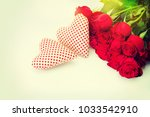 red roses and two hearts | Shutterstock . vector #1033542910
