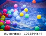 colorful balls in plastic... | Shutterstock . vector #1033544644
