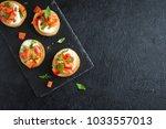 italian bruschetta with chopped ... | Shutterstock . vector #1033557013