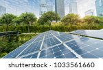 solar panels with cityscape of... | Shutterstock . vector #1033561660
