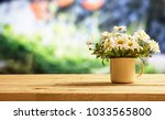 springtime  daisies on wooden... | Shutterstock . vector #1033565800