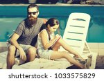 young handsome bearded man with ... | Shutterstock . vector #1033575829