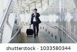 asian young businessman walks...   Shutterstock . vector #1033580344