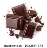 three dark chocolate pieces... | Shutterstock . vector #1033594378