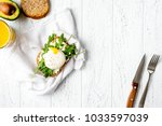 sandwich with poached eggs on... | Shutterstock . vector #1033597039