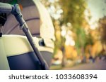 green stroller for a walk | Shutterstock . vector #1033608394