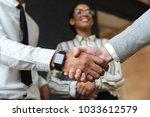 cropped photo of handshake of... | Shutterstock . vector #1033612579