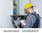 professional electrician... | Shutterstock . vector #1033626529