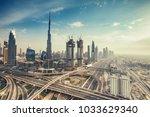 aerial view over big highway... | Shutterstock . vector #1033629340