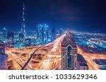 scenic nighttime skyline of a... | Shutterstock . vector #1033629346