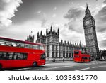 Small photo of London, the UK. Red buses in motion and Big Ben, the Palace of Westminster. The icons of England in vintage, retro style. Red in black and white