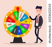 businessman with fortune wheel. ... | Shutterstock . vector #1033632010