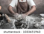 man preparing buns at table in... | Shutterstock . vector #1033651963