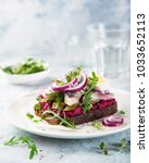Stock photo open sanwich with dark rye bread beet marinated herring pickled cucumber and red onion 1033652113