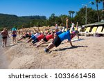 group of people doing sport... | Shutterstock . vector #1033661458