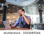 handsome businessman talking... | Shutterstock . vector #1033685566