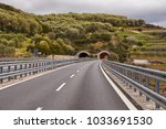 tunnels on a highway  hilly...   Shutterstock . vector #1033691530