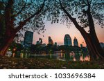 cityscape sunset of lakeside at ... | Shutterstock . vector #1033696384