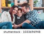 portrait of happy loving family ... | Shutterstock . vector #1033696948