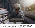 senior office worker using an... | Shutterstock . vector #1033698868
