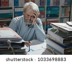 senior businessman working in... | Shutterstock . vector #1033698883