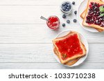 delicious toasts with sweet... | Shutterstock . vector #1033710238