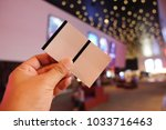 man holding or showing two... | Shutterstock . vector #1033716463
