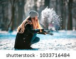 smiling young woman throwing... | Shutterstock . vector #1033716484