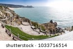 Small photo of PORTHCURNO, UK - MARCH 26, 2013: Minack Theatre in Cornwall built into cliff face by Rowena Cade, an historic open air theatre which attracts tourists