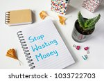 stop wasting money written in... | Shutterstock . vector #1033722703