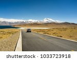 a road to snow mountain | Shutterstock . vector #1033723918