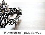 black mask on the wooden... | Shutterstock . vector #1033727929