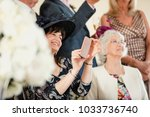 mother of the groom is taking... | Shutterstock . vector #1033736740