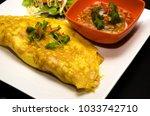 egg wrap thai food omelette... | Shutterstock . vector #1033742710