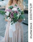 a beautiful wedding bouquet in... | Shutterstock . vector #1033747129