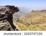 an edge of the cliff hungs over ... | Shutterstock . vector #1033747150