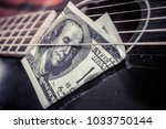 play for money with guitar and... | Shutterstock . vector #1033750144