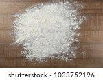 scattered flour on wooden...   Shutterstock . vector #1033752196