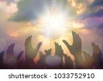 Small photo of Blurred of Christian Congregation hands Worship God together in front of wooden cross in cloudy sky, conceptual image of praise and worship