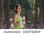 girl drinking water from bottle ...   Shutterstock . vector #1033760839