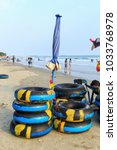 Small photo of Colorful swim rubber ring abd umbrella on the beach , Rayong Thailand