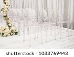 transparent plastic chairs for... | Shutterstock . vector #1033769443