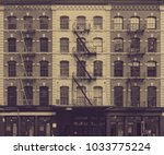 old faded wall of windows on... | Shutterstock . vector #1033775224