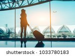 silhouette woman travel with... | Shutterstock . vector #1033780183