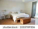 interior of a comfortable bed... | Shutterstock . vector #1033789306
