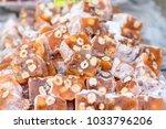 turkish delight with hazelnut. | Shutterstock . vector #1033796206
