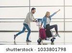 romantic couple in airport.... | Shutterstock . vector #1033801798
