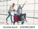 romantic couple in airport.... | Shutterstock . vector #1033801804